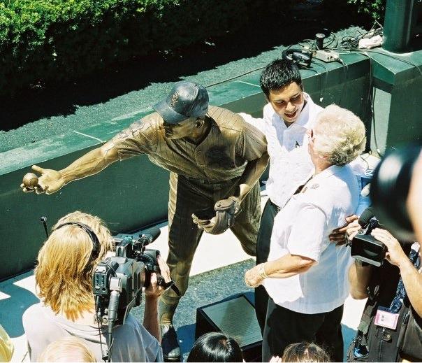 Joanne Fox Looking at Nellie Fox Sculpture